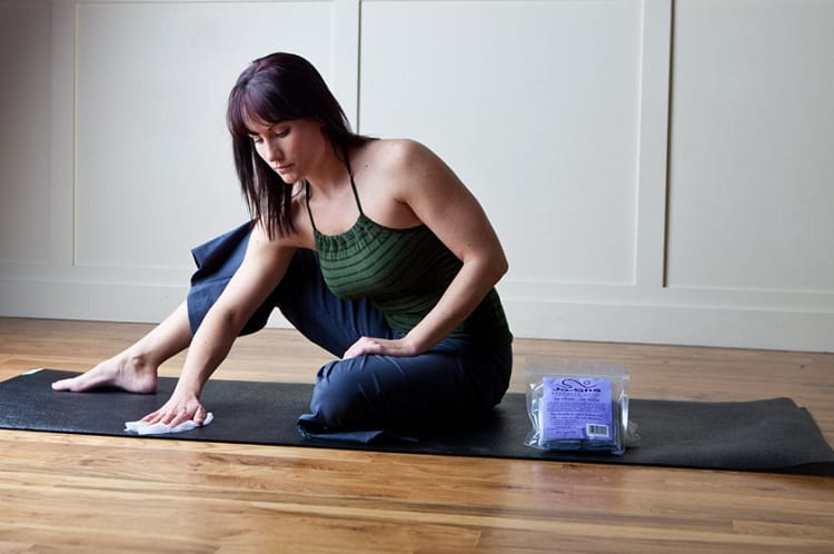 Woman Cleaning Yoga Mat