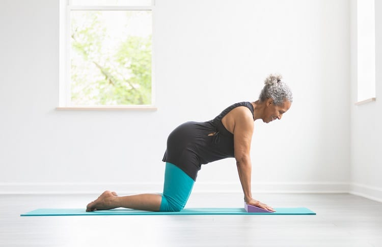 Woman Doing Yoga For Recovery