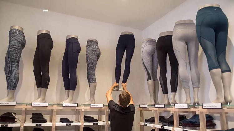 Adjusting Dolls In Yoga Pants Store